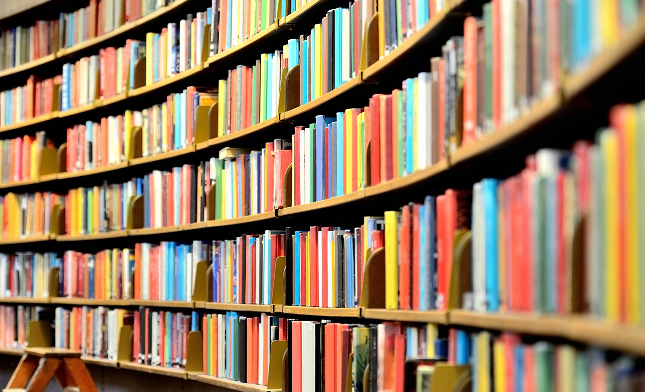 a colorful shot of bookshelves at a library